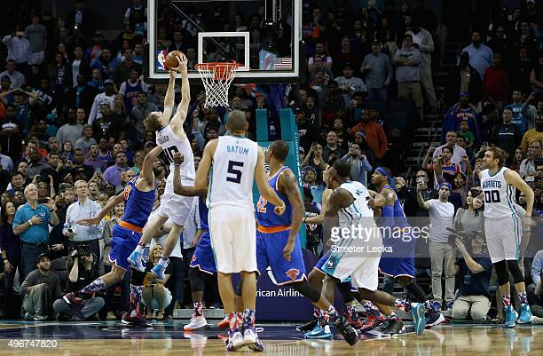 Cody Zeller of the Charlotte Hornets hits the game winning shot to defeat the New York Knicks 9593 during their game at Time Warner Cable Arena on...