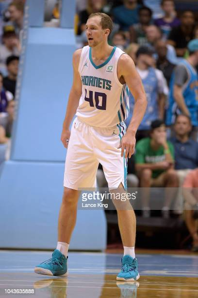 Cody Zeller of the Charlotte Hornets in action against the Boston Celtics in the first quarter of a preseason game at Dean Smith Center on September...