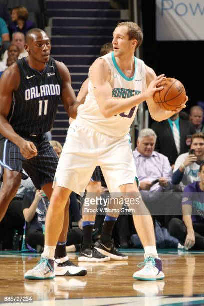 Cody Zeller of the Charlotte Hornets looks to pass the ball against the Orlando Magic on December 4 2017 at Spectrum Center in Charlotte North...