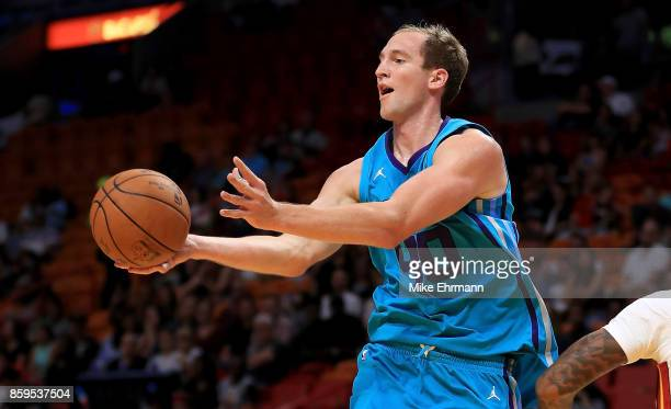 Cody Zeller of the Charlotte Hornets passes during a preseason game against the Miami Heat at American Airlines Arena on October 9 2017 in Miami...
