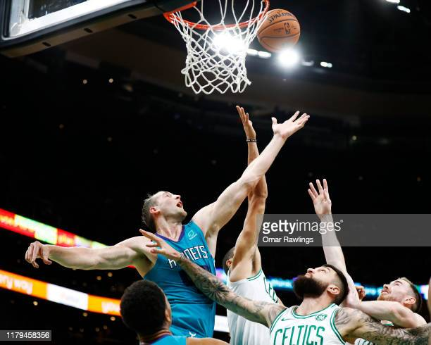 Cody Zeller of the Charlotte Hornets rebounds the ball during the second quarter of the game against the Boston Celtics at TD Garden on October 06...