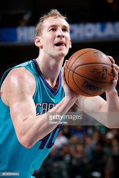 Cody Zeller of the Charlotte Hornets shoots a free throw against the Dallas Mavericks on December 5 2016 at the American Airlines Center in Dallas...