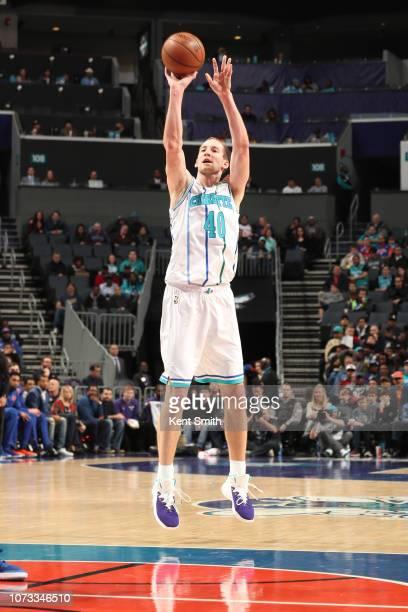 Cody Zeller of the Charlotte Hornets shoots the ball against the New York Knicks on December 14 2018 at Spectrum Center in Charlotte North Carolina...
