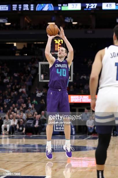 Cody Zeller of the Charlotte Hornets shoots the ball against the Minnesota Timberwolves on December 5 2018 at Target Center in Minneapolis Minnesota...