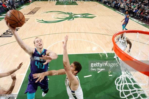 Cody Zeller of the Charlotte Hornets shoots the ball against the Milwaukee Bucks on March 9 2019 at the Fiserv Forum Center in Milwaukee Wisconsin...