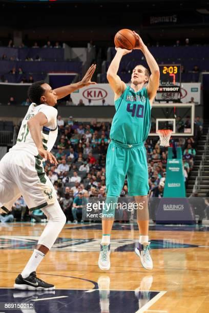 Cody Zeller of the Charlotte Hornets shoots the ball against the Milwaukee Bucks on November 1 2017 at Spectrum Center in Charlotte North Carolina...