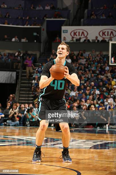 Cody Zeller of the Charlotte Hornets shoots the ball against the Golden State Warriors on December 2 2015 at Time Warner Cable Arena in Charlotte...