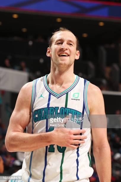 Cody Zeller of the Charlotte Hornets smiles during the game against the New York Knicks on December 14 2018 at Spectrum Center in Charlotte North...
