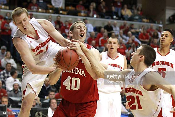 Cody Zeller of the Indiana Hoosiers attempts to control the ball against Mike Bruesewitz and Josh Gasser of the Wisconsin Badgers during their...