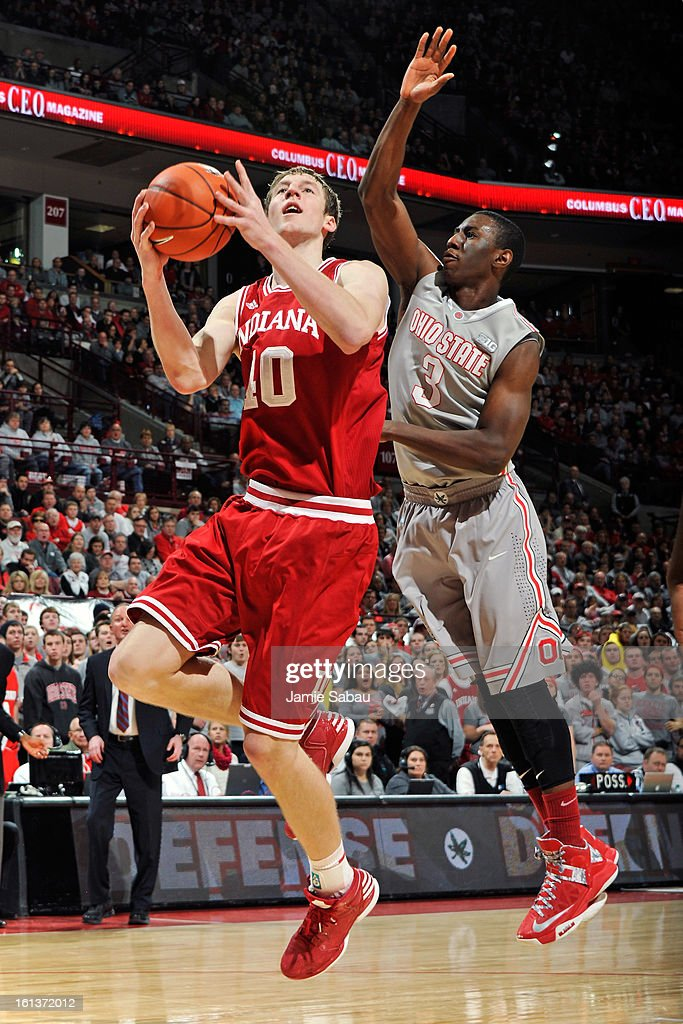 Cody Zeller #40 of the Indiana Hoosiers drives to the hoop to lay in the ball past the defense of Shannon Scott #3 of the Ohio State Buckeyes in the first half on February 10, 2013 at Value City Arena in Columbus, Ohio.