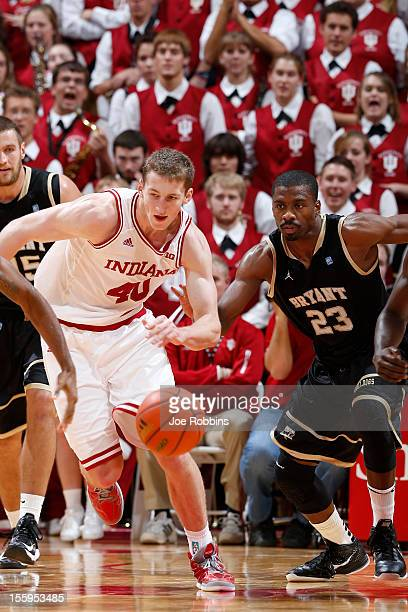 Cody Zeller of the Indiana Hoosiers goes for a loose ball against Alex Francis of the Bryant Bulldogs during the game at Assembly Hall on November 9...