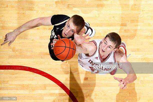 Cody Zeller of the Indiana Hoosiers goes for a rebound against Andrew Scocca of the Bryant Bulldogs during the game at Assembly Hall on November 9...