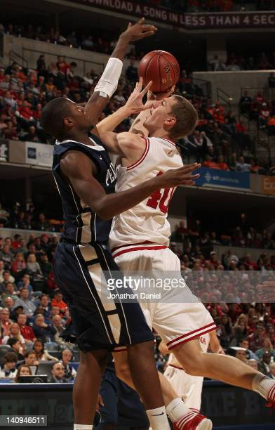 Cody Zeller of the Indiana Hoosiers goes up for a shoot against Jon Graham of the Penn State Nittany Lions during the first round of the Big Ten...