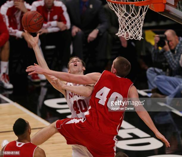 Cody Zeller of the Indiana Hoosiers tries to shoot against Jared Berggren of the Wisconsin Badgers during a semifinal game of the Big Ten Basketball...