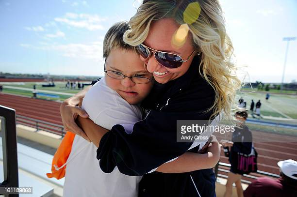 RANCH CODylan Secrist 13yearsold with Down Syndrome left gets a hug from Denver Broncos cheerleader Jenna Jaeger at Valor Christian High School...