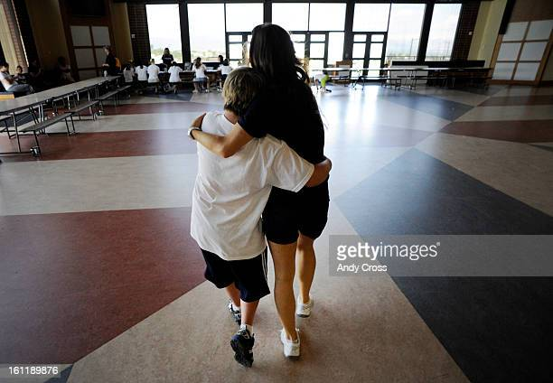 RANCH CODylan Secrist 13yearsold with Down Syndrome left gets a hug from Denver Broncos cheerleader Kara Dingboom right inside the Valor Christian...
