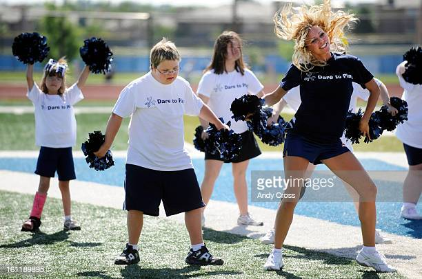 RANCH CODylan Secrist 13yearsold with Down Syndrome second from left works a cheer routine from Denver Broncos cheerleader Jenna Jaeger right along...