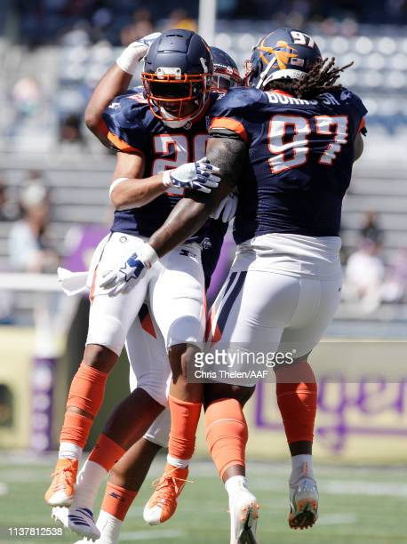 Cody Riggs celebrates with Izaah Burks Sr #97 of the Orlando Apollos during the second half against the Atlanta Legends in an Alliance of American...