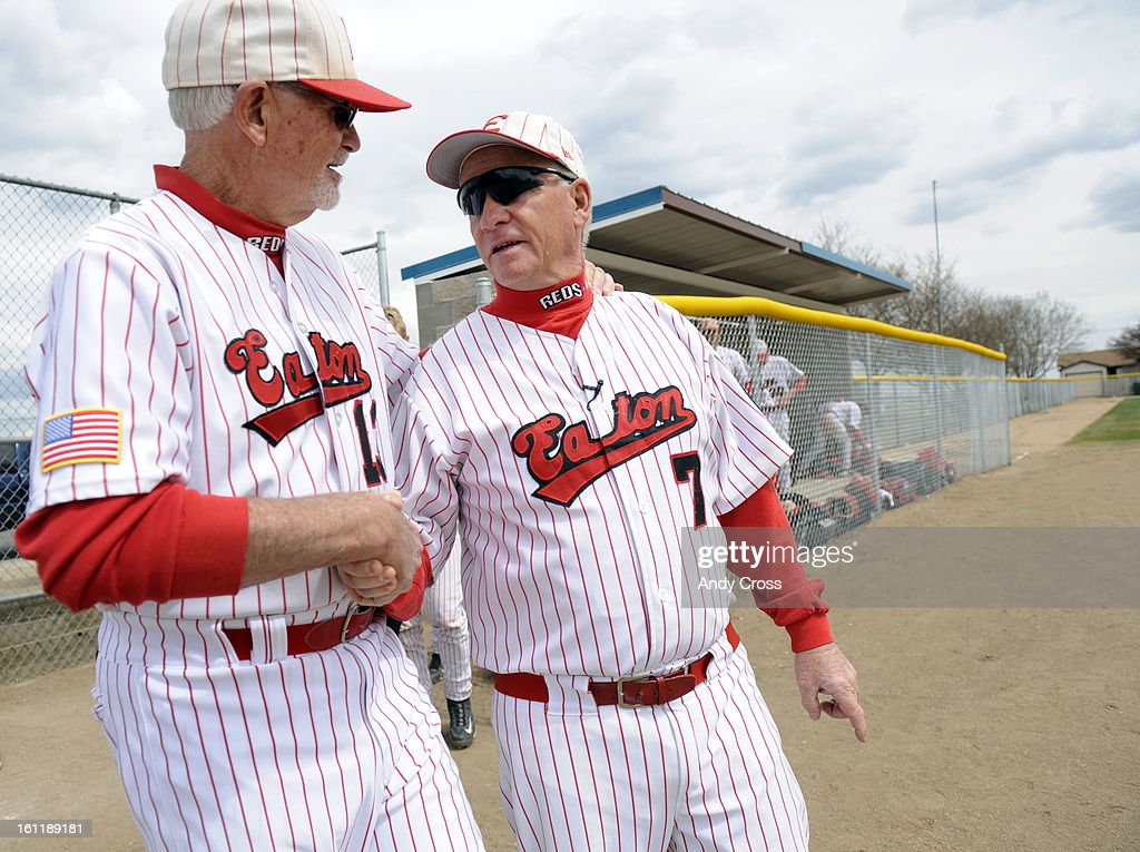 KERSEY, CO--Eaton Reds Assistant coach, Bob Ervin, left, congratulates head coach, Jim Danley after defeating Platte Valley in Kersey Colorado Saturday April 16th 2011 giving Danley his 700th win. Andy Cross, The Denver Post : News Photo