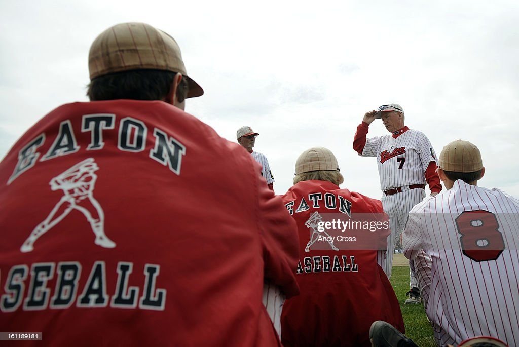 KERSEY, CO--Eaton Reds coach, Jim Danley #7, talks with his team after defeating Platte Valley in Kersey Colorado Saturday April 16th 2011 for his 700th win. Andy Cross, The Denver Post : ニュース写真
