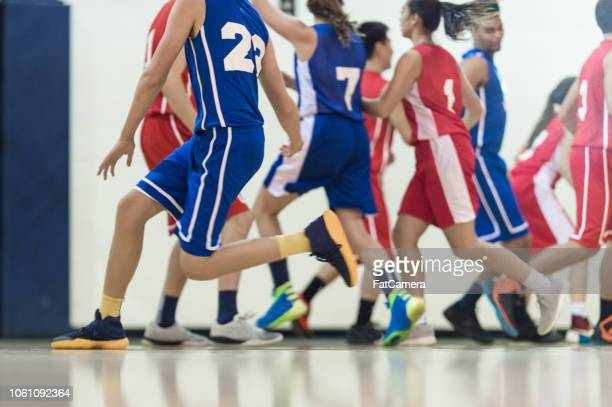 co-ed basketball game - charging sports stock pictures, royalty-free photos & images