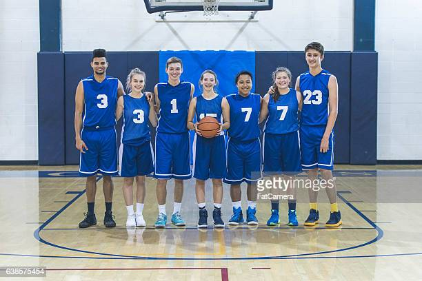 Co-ed  group of high school basketball players in