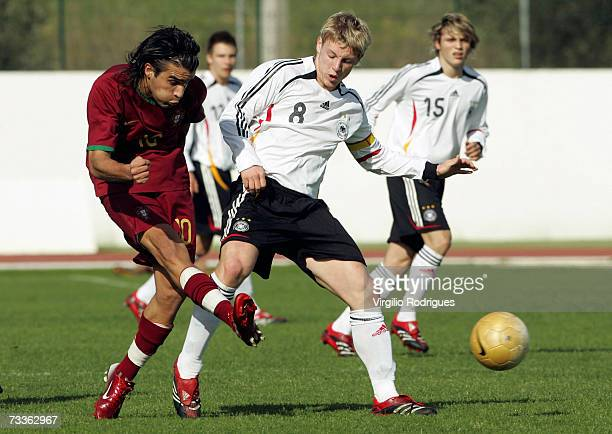 Coelho of Portugal vies for the ball with Patrick Funk of Germany during the Men's U17 international Tournament match between Portugal and Germany at...
