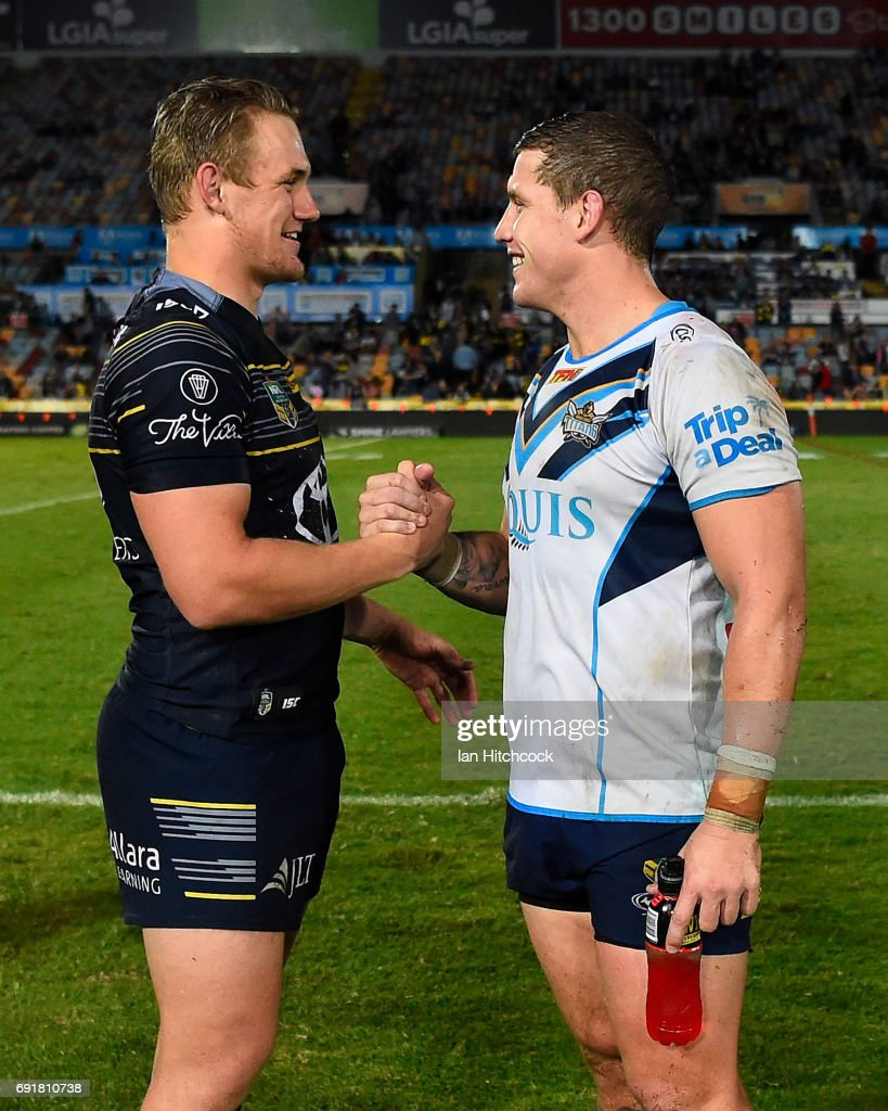 Coen Hess of the Cowboys and Jarrod Wallace of the Titans talk with each other at the end of the round 13 NRL match between the North Queensland Cowboys and the Gold Coast Titans at 1300SMILES Stadium on June 3, 2017 in Townsville, Australia.
