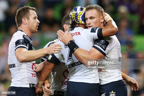Coen Hess of the Cowboys celebrates a try during the round three NRL match between the Melbourne Storm and the North Queensland Cowboys at AAMI Park...