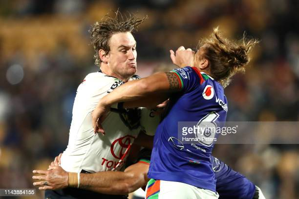 Coen Hess of the Cowboys fends off Chanel HarrisTavita of the Warriors during the round 6 NRL match between the Warriors and the Cowboys at Mt Smart...