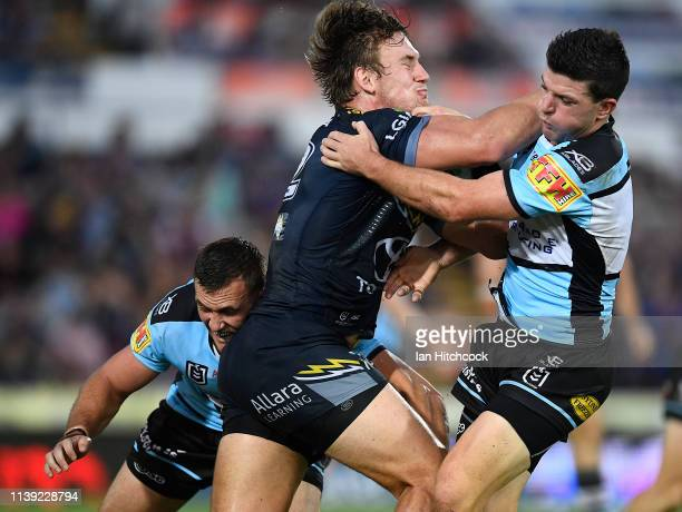 Coen Hess of the Cowboys is tackled by Chad Townsend of the Sharks during the round three NRL match between the North Queensland Cowboys and the...