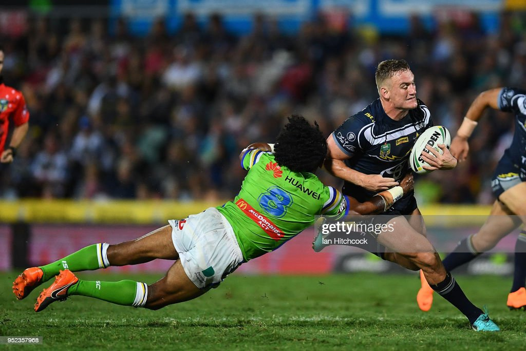 Coen Hess of the Cowboys is tackled by Iosia Soliola of the Raiders during the round eight NRL match between the North Queensland Cowboys and the Canberra Raiders at 1300SMILES Stadium on April 28, 2018 in Townsville, Australia.