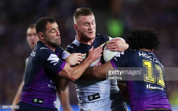 Coen Hess of the Cowboys is tackled during the 2017 NRL Grand Final match between the Melbourne Storm and the North Queensland Cowboys at ANZ Stadium...