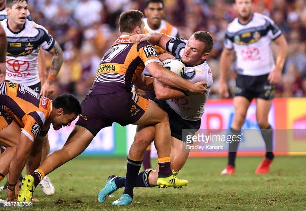 Coen Hess of the Cowboys is tackled during the round two NRL match between the Brisbane Broncos and the North Queensland Cowboys at Suncorp Stadium...