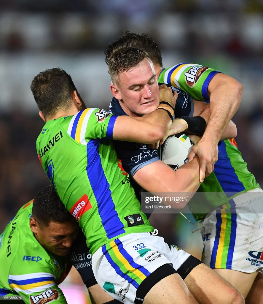 Coen Hess of the Cowboys is wrapped up by the Raiders defence during the round eight NRL match between the North Queensland Cowboys and the Canberra Raiders at 1300SMILES Stadium on April 28, 2018 in Townsville, Australia.
