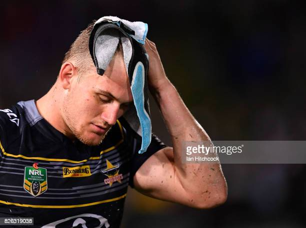 Coen Hess of the Cowboys looks dejected after losing the round 22 NRL match between the North Queensland Cowboys and the Melbourne Storm at...