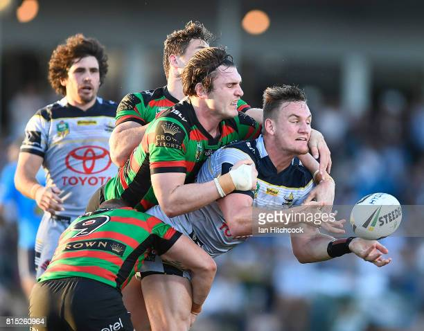 Coen Hess of the Cowboys makes an offload during the round 19 NRL match between the South Sydney Rabbitohs and the North Queensland Cowboys at Barlow...