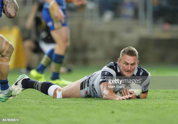 Coen Hess of the Cowboys scores a try during the NRL Semi Final match between the Parramatta Eels and the North Queensland Cowboys at ANZ Stadium on...