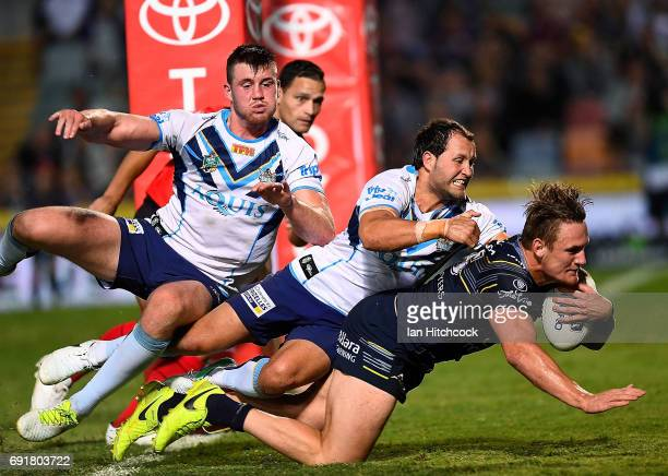 Coen Hess of the Cowboys scores a try during the round 13 NRL match between the North Queensland Cowboys and the Gold Coast Titans at 1300SMILES...