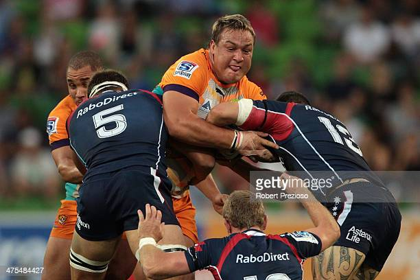 Coenie Oosthuizen of the Cheetahs is tackled during the round three Super Rugby match between the Melbourne Rebels and the Cheetahs at AAMI Park on...