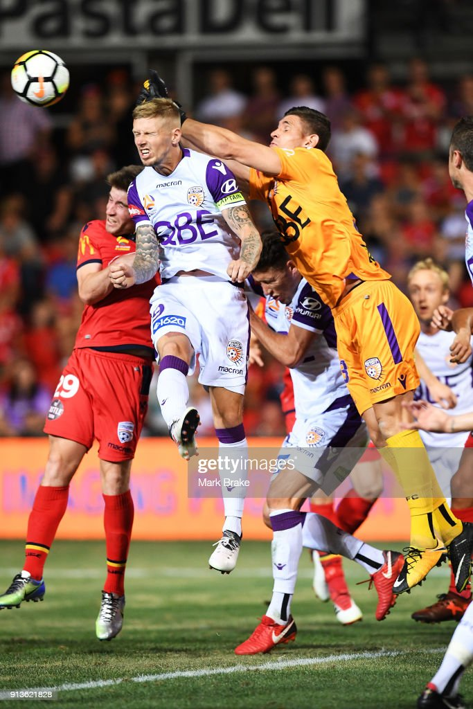 cof Perth Glory saves over Andrew Keogh of Perth Glory and Ben Garuccio of Adelaide United during the round 19 A-League match between Adelaide United and the Perth Glory at Coopers Stadium on February 3, 2018 in Adelaide, Australia.