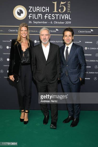 CoFestival director Nadja Schildknecht Roland Emmerich and ZFF CoFestival director Karl Spoerri attend the The Day After Tomorrow premiere during the...