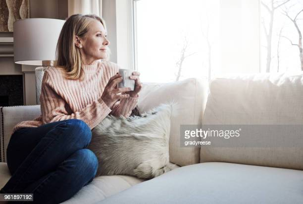 coffee and a quiet moment - mature women stock pictures, royalty-free photos & images