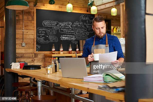 coffee and accounts - business owner stock photos and pictures