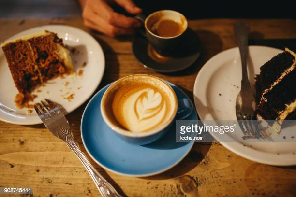 Coffee and cake on the table in a cafe in East London