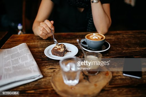 Coffee and cake on the table in a cafe in London downtown