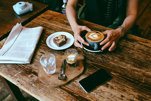 Coffee and cake on the table in a cafe in London downtown 925905464