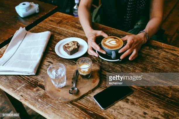 coffee and cake on the table in a cafe in london downtown - chocolate cake above stock pictures, royalty-free photos & images