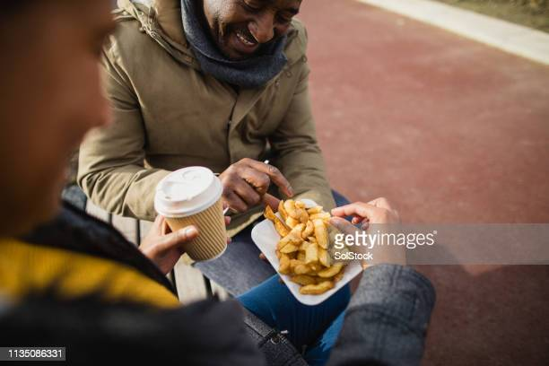 coffee and chips - outdoor pursuit stock pictures, royalty-free photos & images