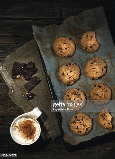 Coffee and chocolate with a pan of freshly baked cookies.